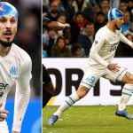 Making a splash! Marseille striker Dario Benedetto treated for head injury by being given a SWIMMING CAP as French club stumble to late draw with Amiens