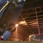 NYC bendy bus left dangling from overpass in Bronx